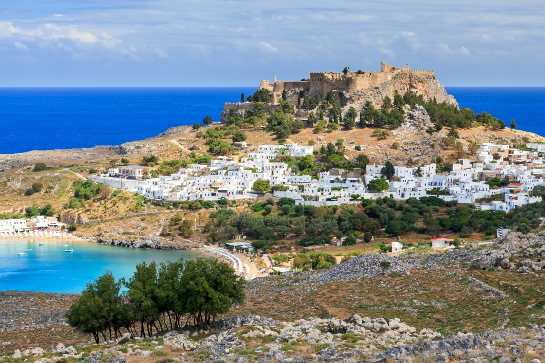 'View from the road down to the popular town of Lindos on the Island of Rhodes Greece' - Rodi
